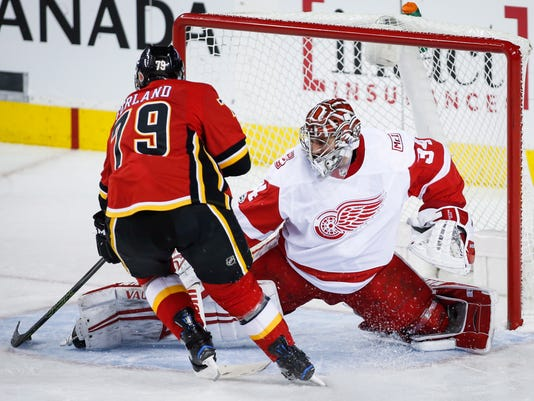 Detroit Red Wings goalie Petr Mrazek, right, of the Czech Republic, lets in a goal from Calgary Flames' Matthew Tkachuk during the second period of an NHL hockey game Thursday, Nov. 9, 2017, in Calgary, Alberta. (Jeff McIntosh/The Canadian Press via AP)