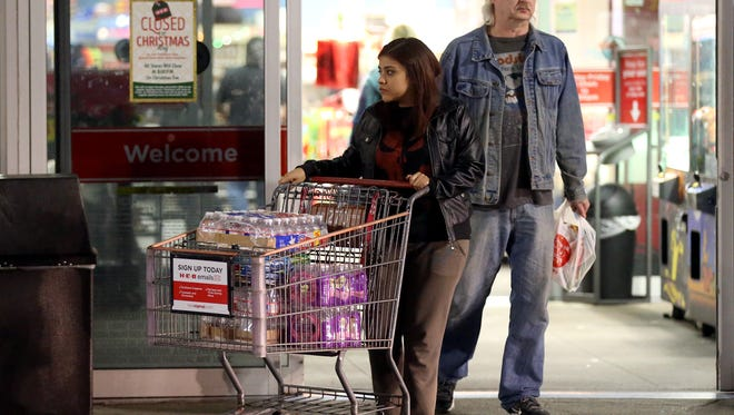 Residents exit H-E-B with bottles of water on Staples St. and SPID after a recent back-flow incident in the industrial district according to a city news release Thursday, Dec. 15, 2016, in Corpus Christi.