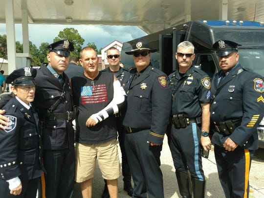 Patrolman Chris Burans and Cpl. Kevin Boone meet with other officers in Baton Rouge, including one who was injured in an attack.