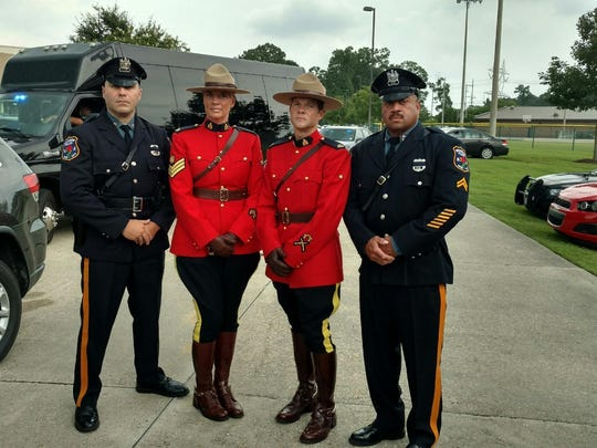 Patrolman Chris Burans and Cpl. Kevin Boone meet with Canadian Mounted Police in Baton Rouge.