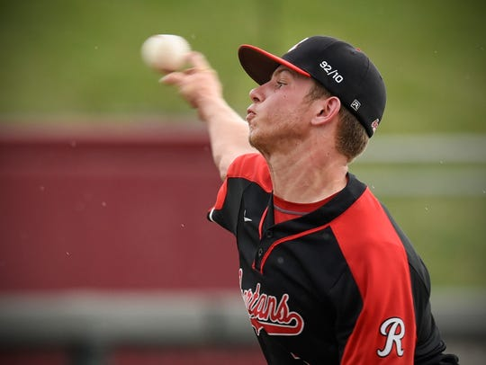 Rocori pitcher Brandon Gill throws to a New Ulm batter