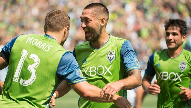 Seattle Sounders midfielder Clint Dempsey celebrates with forward Jordan Morris (left) after scoring a goal during the first half against Sporting Kansas City on Saturday.