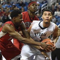 UNLV's Dwayne Morgan, left, attempts to take the ball away from AJ West during their game in Reno this season.