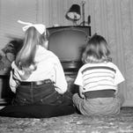 Alyne, 8, left, and Candy, 5, daughters of Mr. and Mrs. R.C. Kennedy of Bartlesville, Okla., are all set to watch a movie on their television set on March 7, 1958.