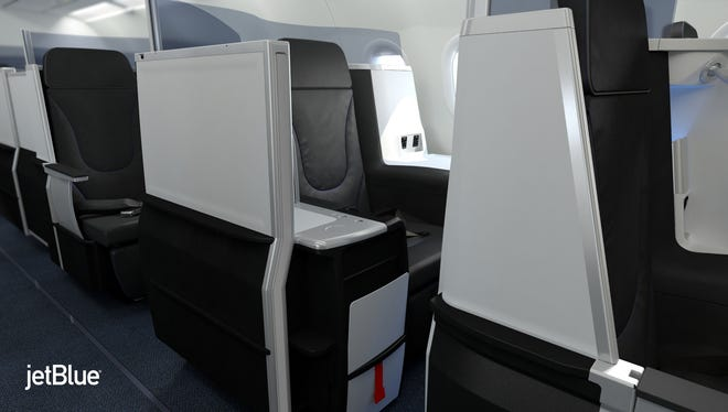 JetBlue?'s new lie-flat seats that will debut JUne 2014 on the carrier's JFK-California flights.