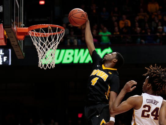 Iowa's Isaiah Moss (4) dunks on his way to 12 first-half