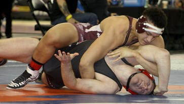 Wolves wrap up team title at Mat Classic