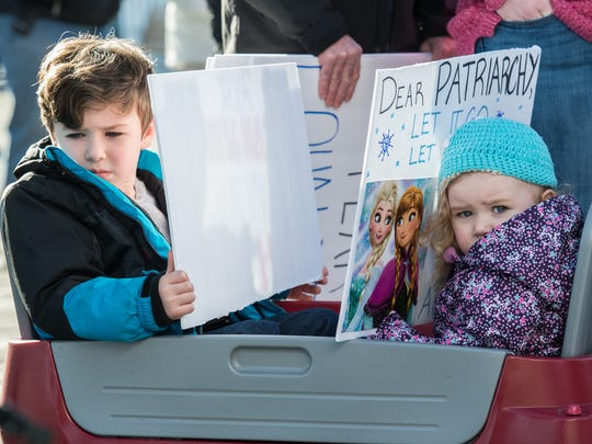 Winston Soulis, 5, of Hebron, Maryland and his sister Violet, 3, await the start of the Empowering Women: Women's March Reunion Rally in Ocean City, Maryland on Sunday, Jan. 21, 2018.