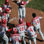 Japan's Masafuji Nishijima, top center, leaps on home plate after hitting a three-run home run off Lewisberry, Pa.'s Jaden Henline in the third inning of the Little League World Series Championship baseball game in South Williamsport, Pa. Sunday.