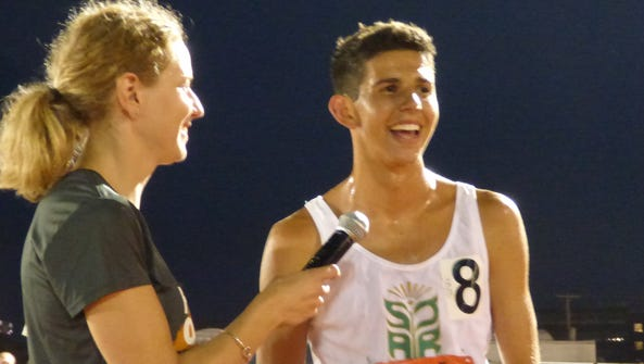 Grant Fisher of Grand Blanc talks about his race Thursday,