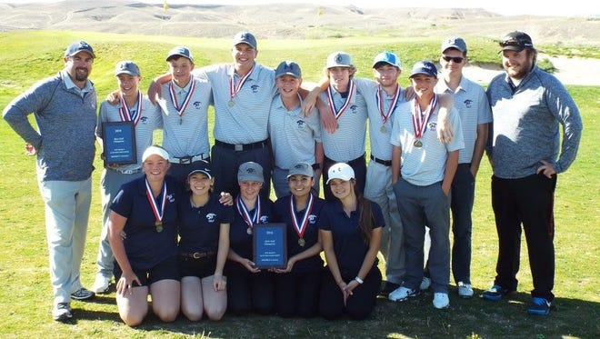 The Piedra Vista boys and girls golf teams pose for a photo after winning the District 1-5A titles Monday at the Riverview Golf Course in Kirtland.
