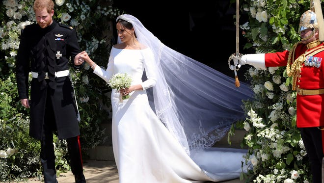 Prince Harry and the former Meghan Markle leave after their wedding ceremony at St. George's Chapel in Windsor Castle, May 19, 2018.