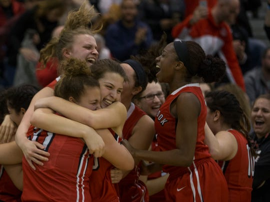 Bound Brook celebrate their finals title. Bound Brook vs University in Public Group 1 Girls Basketball Final in Toms River NJ, on March 12, 2017.