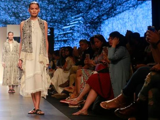 In this Feb. 1, 2017 photo, Anjali Lama, a transgender model from Nepal, displays a creation by designer Gen Next during Lakme Fashion week in Mumbai, India. To model for Lakme Fashion Week, one of the highlights of India's fashion calendar, is Lama's big moment. It's a dream that was years in the making and often seemed far beyond the reach of Lama now being touted as the first transgender woman to model for the high fashion event sponsored by a top Indian cosmetics brand.