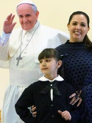 Ana Ortega, 7, a first-grader, was chosen by the Catholic Diocese of Juárez to be one of four children who will present Pope Francis with flowers upon his arrival at the Juárez airport during his Feb. 17 visit. Her mother, right, also is named Ana Ortega.