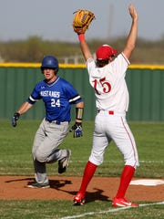 City View's Jackson Merrick, left, stops at second in the game against Holliday Tuesday, March 21, 2017, in Holliday. The Eagles defeated the Mustangs 16-0.