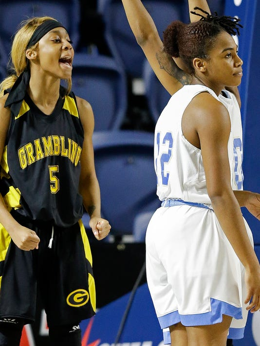 Grambling State guard Shakyla Hill (5) reacts after drawing a foul during the first half of an NCAA college basketball game against Southern in the championship of the Southwestern Athletic Conference, Saturday, March 10, 2018, in Houston. (AP Photo/Eric Christian Smith)