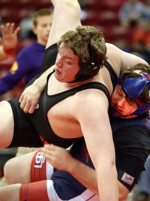 Southern Door's Mitchell Overbeck throws down opponent Austin Connor of Amery in the WIAA D-2 quarter finals of the Individual State Wrestling Tournament in Madison Friday. Overbeck took the 285-weight class match by decision 7-2.