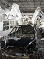 Robots apply paint at Honda's East Liberty, Ohio Auto Plant. The company on Wednesday said it will invest $85 million into the plant to boost production of its Acura MDX.