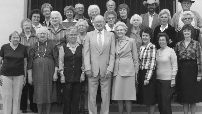 """The Gilbert Historical Society poses outside the museum in 1985. """"Uncle Otto"""" Nealy is front and center."""