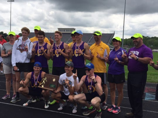 The Lexington boys track team celebrates its regional title in front of the home fans.