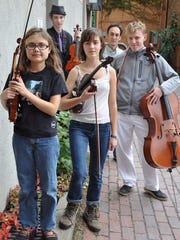 A string quartet from New Roots Charter School will