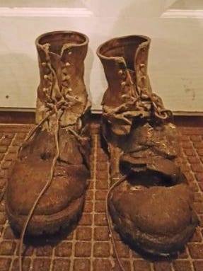 This pair of Red Wings boots owned by Eric Tilderquist have seen better days. The Minnesota dairy farmer says he wears out a pair of boots each year.
