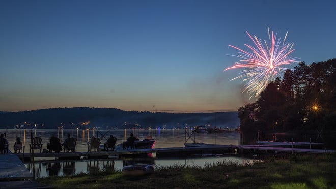 WEST BROOKFIELD - People take in July Fourth fireworks from a dock on Lake Wickaboag on Saturday. Others watched from about 40 boats on the lake.