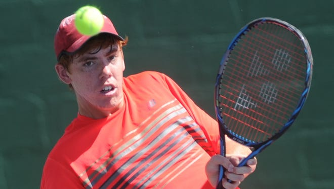 San Antonio's Trey Hilderbrand watches his return shot against Seabrook's Reed Collier. Hilderbrand beat Collier 6-0, 6-1 to win the Boys' 18 Singles title at the USTA Texas Slam on Saturday at ACU's Eager Tennis Center. It's Hilderbrand's first Texas Slam singles title.