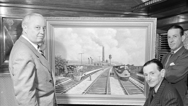 Clark Hungerford; George Hamar, artist and creator of the Frisco West Shops painting; and Jim Jeffries.