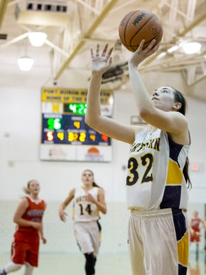 Port Huron Northern junior Bree Bauer takes a shot during a basketball game Friday, Feb. 19, 2016 at Port Huron Northern High School.