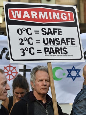 A man marches in Melbourne, Australia, during a climate change rally.