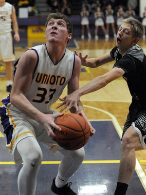 Unioto's Gabe Fisher looks for a shot before a Fairfield Union defender attempts to stop him Tuesday, Dec. 27, 2016, at Unioto High School. Fisher is expected to be a focal point in the Shermans' offense this season.