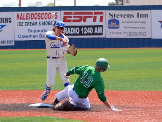 Carlsbad's Josh Echavarria tries to complete a double play in game two against Albuquerque on Saturday.