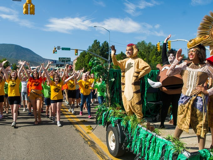 Floats and participants travel along Main Street in