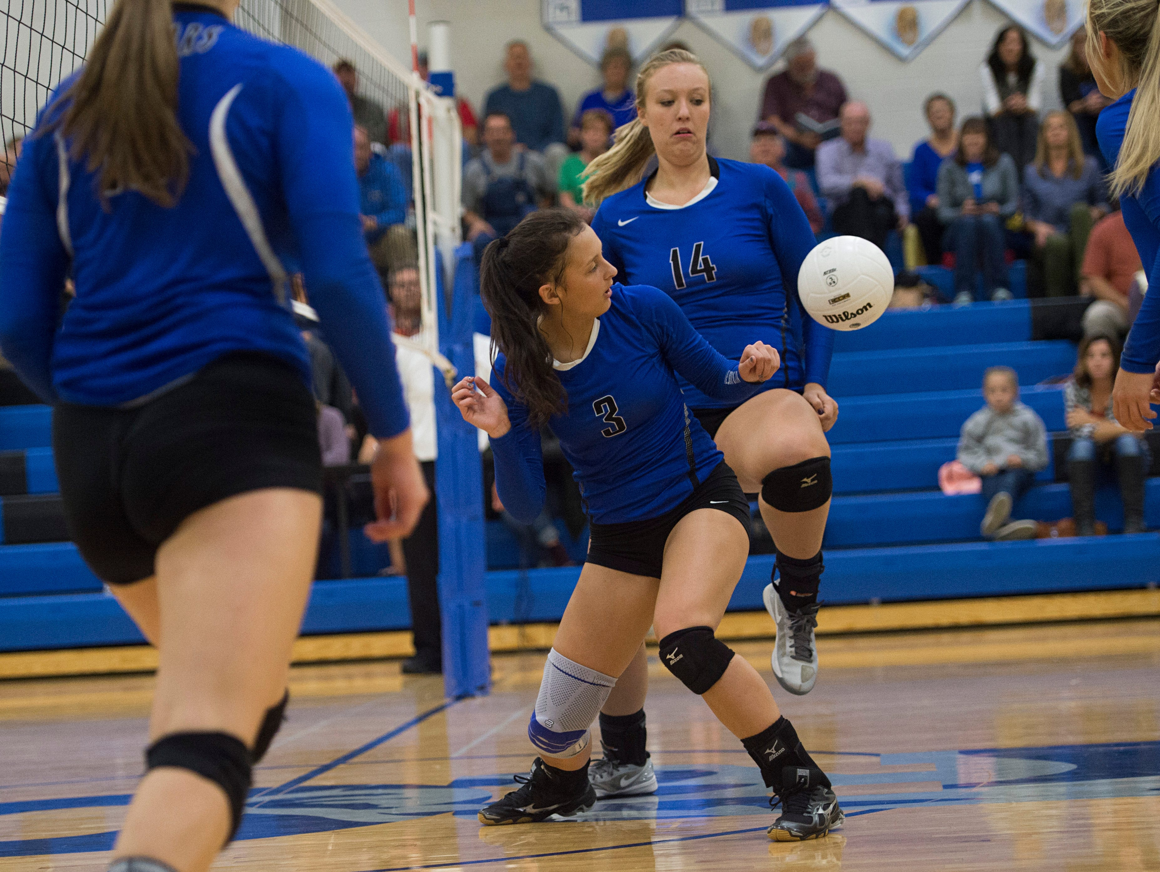 Saylor Webb and Kyra Zuhlke of Resurrection Christian try to gain control of the ball during a game against Eaton at Resurrection Christian School in Loveland Tuesday, October 18, 2016.
