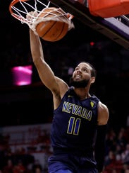Nevada's Cody Martin dunks during the first half of