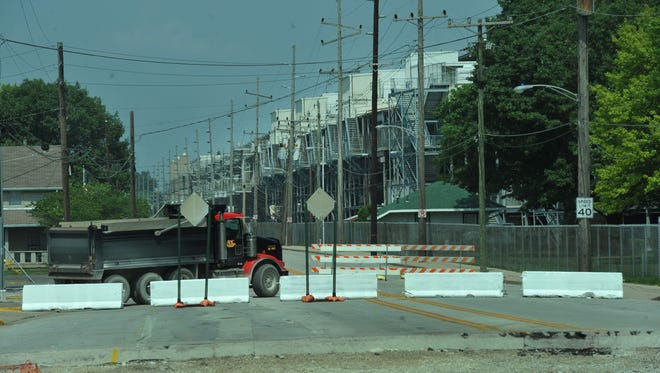 There are no barriers at the south end of Georgetown Road along the west side of Indianapolis Motor Speedway where the roundabout now is.