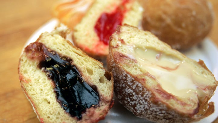 Paczki cut into halves sit on a plate at a Sisters