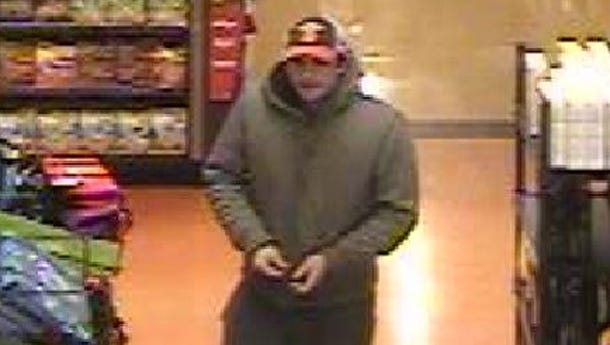 The Greece Police Department is investigating a robbery at the Wegmans in Ridgemont Plaza on Jan. 11, 2016 and released a photo of the suspect who approached a cashier, displayed a knife and demanded money.