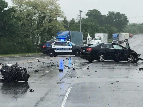 Damage to a car following a nearly head-on collision in South Brunswick in which the driver was allegedly texting.