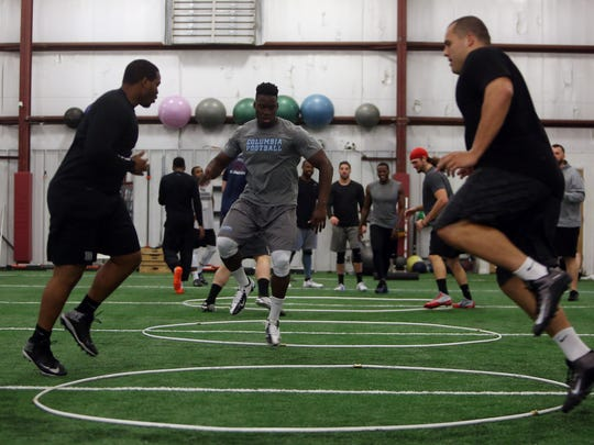 Columbia senior Oluwatoba Akinleye, c, works a skip series of lateral speed drills during an NFL-style workout at TEST Sports in Martinsville.  April 19, 2016. Martinsville, N.J.
