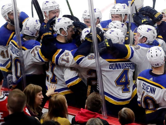 St. Louis Blues center Patrik Berglund (21) celebrates with teammates after scoring the game-winning goal against the Chicago Blackhawks during the overtime period of an NHL hockey game Sunday, March 18, 2018, in Chicago. The Blues won 5-4 in overtime. (AP Photo/Nam Y. Huh)