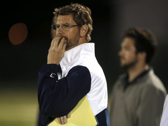 Maclay coach Tyler Hardy, a former Duke All-American, watches his team during their game against Lincoln High School on Tuesday, Feb. 23, 2016.
