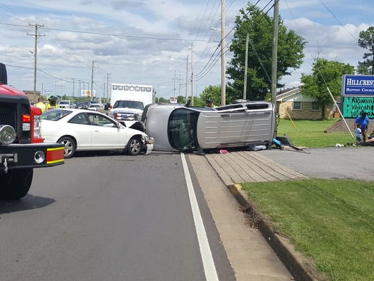 A rollover crash involving an minivan and another vehicle