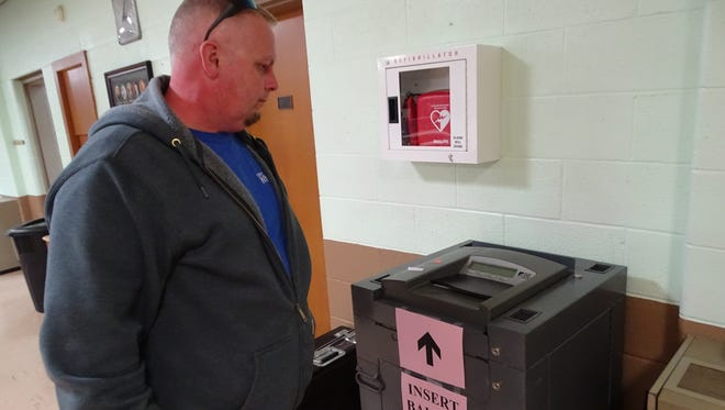 Rodney Pinion waits for his ballot to be accepted before leaving his voting precinct at First United Methodist Church in Clyde.