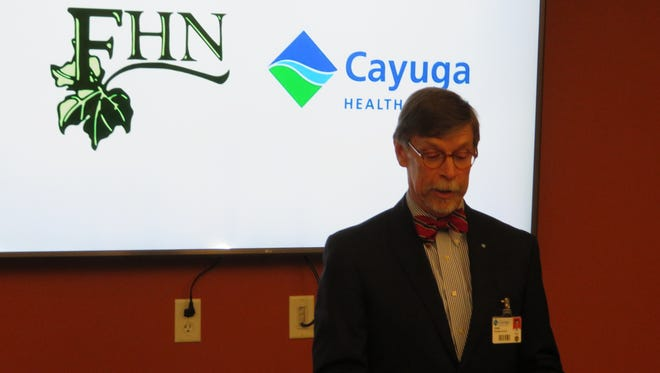 John Rudd, chief executive of Cayuga Health System, announces an affiliation with Family Health Network of Homer at the FHN offices on April 6, 2018.