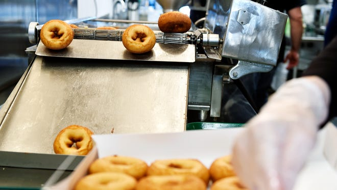 A conveyor belt tips freshly fried doughnuts out of the frying oil at Fractured Prune Doughnuts in the Shrewsbury Commons shopping center. The Shrewsbury store is the first in York County and the 36th store in the U.S. for the Ocean City, Maryland-based Fractured Prune Doughnuts, which CEO Dan Brinton said is opening 190 more stores nationwide. The Fractured Prune specializes in freshly fried doughnuts that are dipped in glazes and topped with sprinkles, sugar or other toppings, all to order. Local store owner Steve Hagee said he hopes to open additional stores in the York area as well as in Harrisburg.