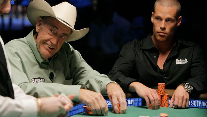 Professional poker players Doyle Brunson, left, and Patrik Antonius play during the Pot-Limit Omaha event of World Series of Poker at the Rio hotel-casino in Las Vegas, Tuesday, July 3, 2007.