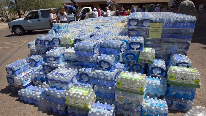 Donated water bottles at the Arizona Department of Health Services in Phoenix.  The water will then be distributed to those in need.